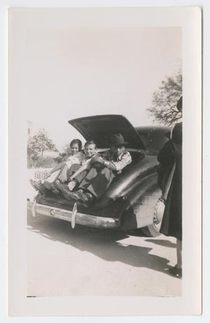 [Students in a Car Trunk]