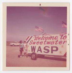 [Women with WASP Sign]
