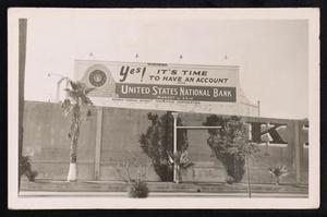 Primary view of object titled '[Postcard of a United States National Bank Billboard]'.