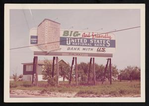 Primary view of object titled '[Photograph of a United States National Bank Billboard]'.