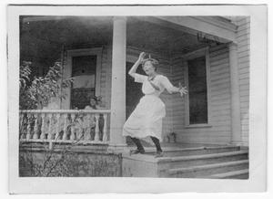 Primary view of object titled 'Unidentified Girl Standing on Steps'.