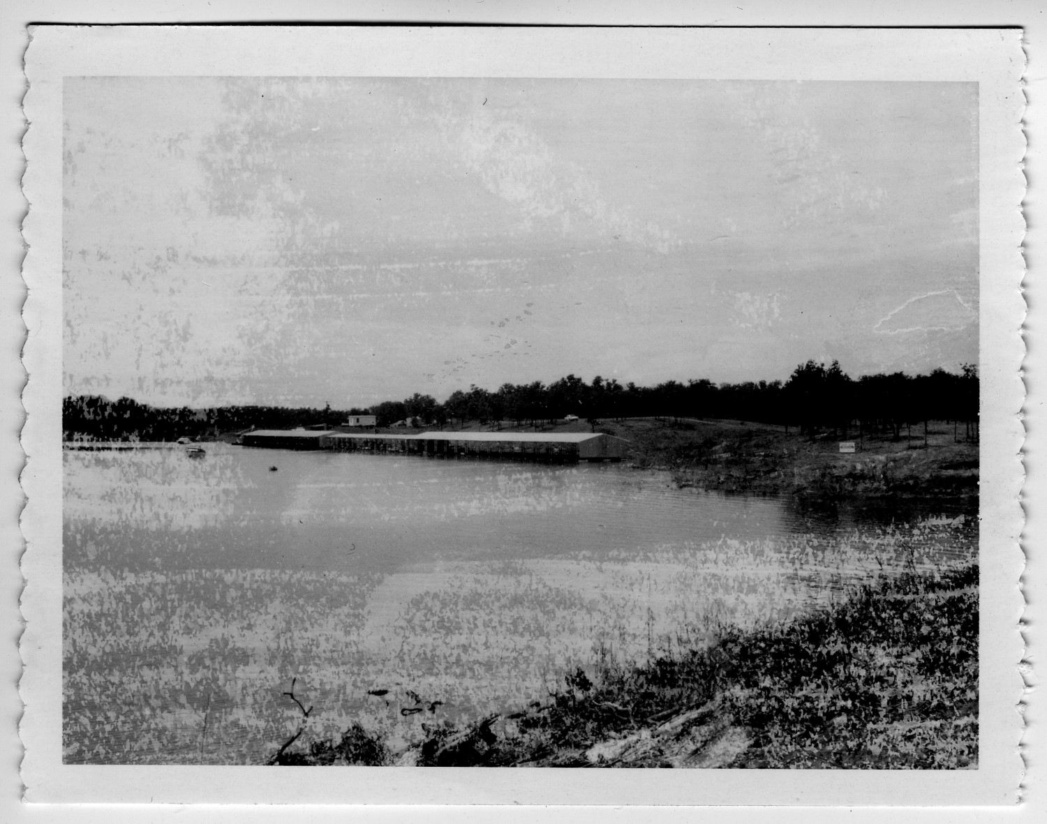 [Photograph of Hickory Creek], Photograph of Hickory Creek. The water curves in a half circle from the left side of the image and the creek moves out of the frame to the bottom-right.,