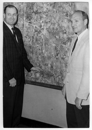 Primary view of object titled 'Park Board Members Crillon Payne and Dr. Jack Watson Standing By Map'.