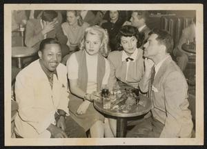 Roy Eldridge at a table with Ava Gardner, others