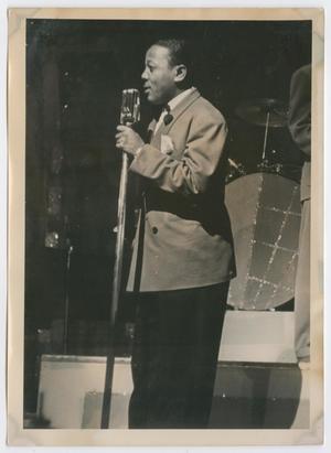 Roy Eldridge speaking into microphone