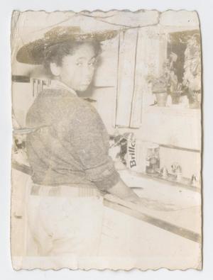 Girl at kitchen sink