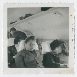 Primary view of Ella Fitzgerald and another woman sleeping on a plane