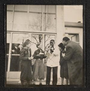 Roy Eldridge playing the trumpet for young boys