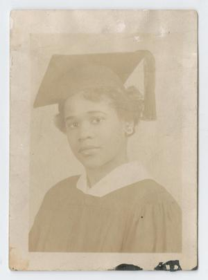 Young woman in graduation cap and gown