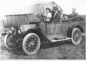 Primary view of object titled '[Four unidentified men in a 1913 Buick]'.