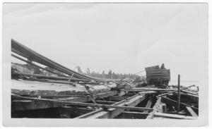 Primary view of [Damaged pipelines and railroad tracks near the port after the 1947 Texas City Disaster]