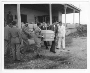 Primary view of object titled '[Carrying a coffin in preparation for the mass funeral service for victims of the 1947 Texas City Disaster]'.