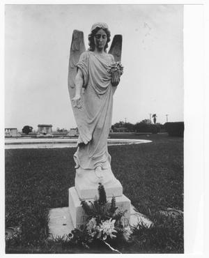 Primary view of object titled '[The Angel statue at Memorial Park honoring the Texas City firefighters lost in the 1947 Texas City Disaster]'.