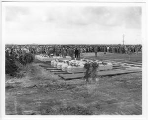 Primary view of object titled '[At the mass funeral service for victims of the 1947 Texas City Disaster]'.