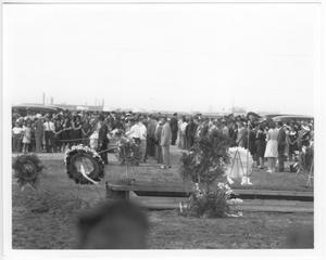 [At the mass funeral service for victims of the 1947 Texas City Disaster]