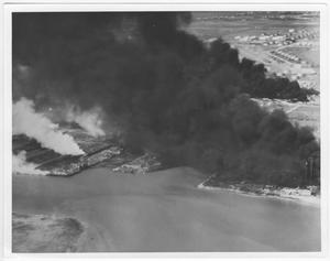 Primary view of object titled '[An aerial view of the docks and slips at the port after the 1947 Texas City Disaster]'.