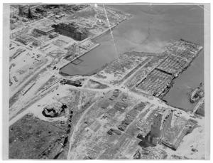 Primary view of object titled '[Aerial view of the grain elevator, the Monsanto building and the Wilson B. Keene after the 1947 Texas City Disaster]'.