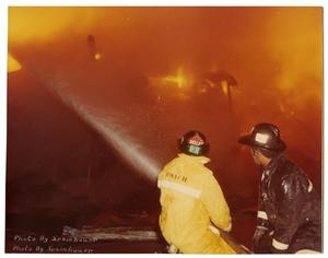 Primary view of object titled '[Two Firemen at a Fire Scene]'.