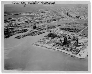 Primary view of object titled '[Aerial view of the Monsanto plant, refinery structures and port after the 1947 Texas City Disaster]'.