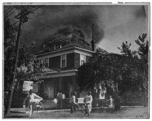 Primary view of object titled '[Rescuing Belongings From a House on Fire]'.