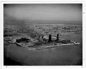 Primary view of object titled '[Aerial view of refinery structures near the port after the 1947 Texas City Disaster]'.