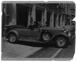 Primary view of object titled '[Chief Coffman in Car with an Unknown Officer]'.