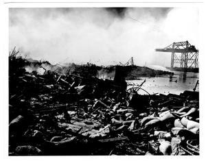Primary view of object titled '[Across from the Seatrain loading crane after the 1947 Texas City Disaster]'.