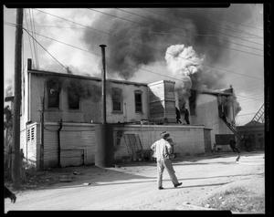 Primary view of object titled '[Man In Front of Burning Building]'.