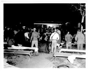 Primary view of object titled '[Survivors and rescue workers at an aid station after the 1947 Texas City Disaster]'.
