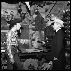 Primary view of object titled '[Two Men Inside a Shop]'.