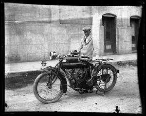 Primary view of object titled '[Portrait of Man and Indian Motorcycle]'.