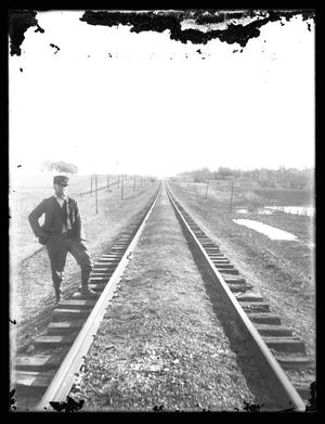 Primary view of object titled '[Man Posing by Railroad Tracks]'.