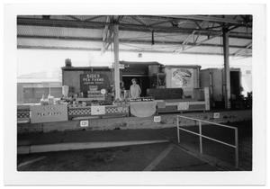 Primary view of object titled '[Pea Vendor at Dallas Farmer's Market]'.
