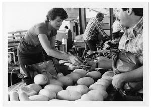 Primary view of object titled '[Seller at Farmer's Market]'.