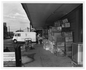 Primary view of object titled '[Wooden Crates on Loading Dock]'.