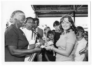 Primary view of object titled '[Girl Accepting Award at Farmer's Market]'.
