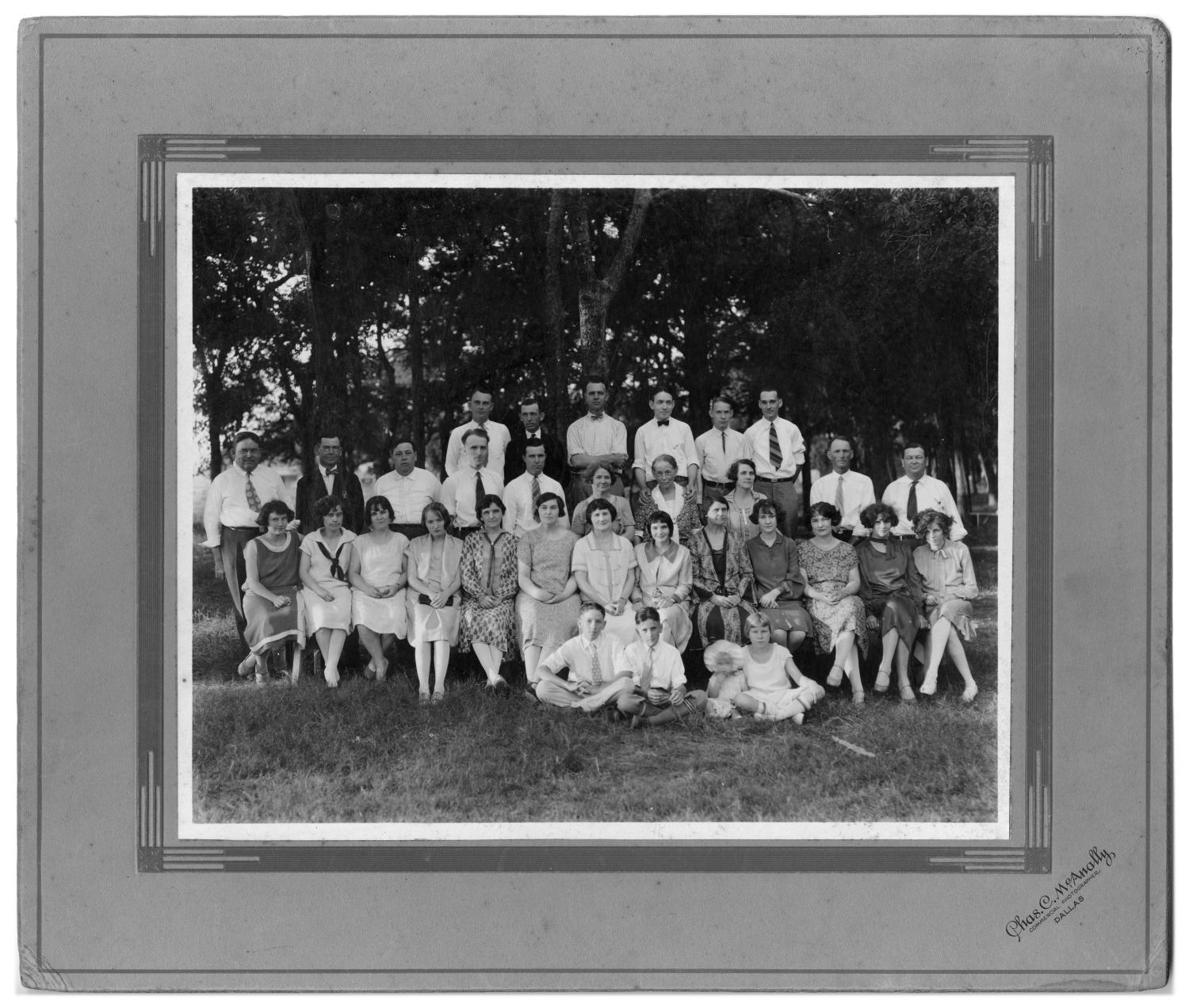 Harben - Spotts Company, Harbens Drug Store and Richardson Telephone Company Annual Picnic, Photograph of a group portrait at the Harben-Spotts Company annual picnic at Kidd Springs. The picnic involved Harbens Drug Store and Richardson Telephone Company. The men, women, and children are identified as (seated on ground, first row) Earle Harben, Ray Chap Harben, Marjorie Mae Meyer, Lewis, (second row) Mrs. M. M. Meyer, Miss Florence Ingle, Mrs. Walter Williams, Miss Ethel Christopherson, Mrs. P. E. Riley, Miss Stella Moody, Mrs. Sam P. Harben, Mrs. Doyal Taylor, Mrs. Sherwood Spotts, Miss Alma Ballard, Miss Viola Anderton, Mrs. A. O. Very, Mrs. Chester Bethel, (third row) Sam P. Harben, Dr. P. E. Riley, Jess Harben, A. O. Very, Chester Bethel, Mrs. Walter Park, Mrs. R. P. Harben, Mrs. Jess Harben, Walter Park, Sherwood Spotts, (fourth row) Doyal Taylor, Walter Williams, J. D. McNeil, Carson Harben, Lester Meyer, and M. M. Meyer.,