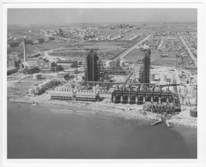 Primary view of object titled '[Aerial view of refinery facilities and the storage tank farm before the 1947 Texas City Disaster]'.