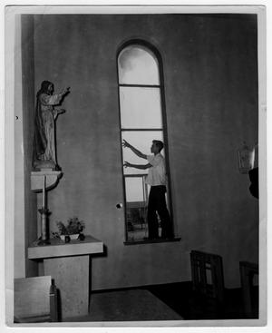 Broken window in a church after the 1947 Texas City Disaster