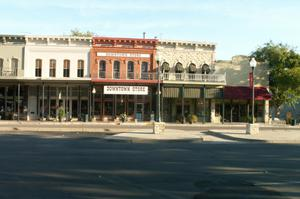 Primary view of object titled '[Stores in Downtown Granbury]'.
