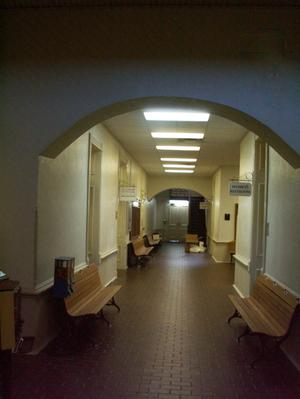 Primary view of object titled '[Benches in a Hallway]'.
