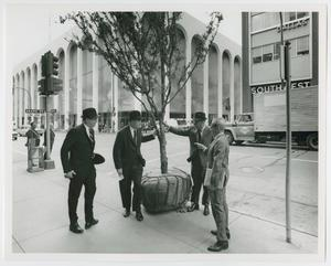 Primary view of object titled '[Men with a Tree for the Thanks-Giving Square Tree Planting Ceremony]'.