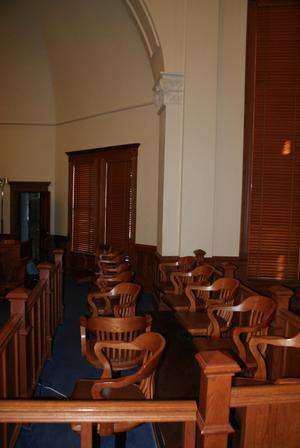 Primary view of object titled '[Chairs in Courtroom]'.