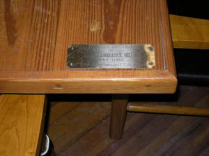 Primary view of object titled '[Plaque on Table]'.