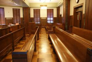 Primary view of object titled '[Benches in Courtroom]'.