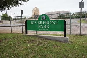 Primary view of object titled '[Riverfront Park Sign]'.