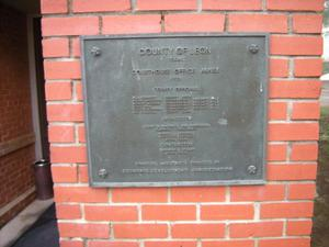 Primary view of object titled '[Plaque on Building]'.