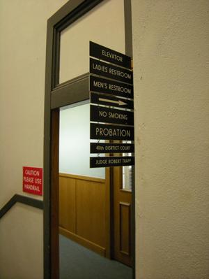 Primary view of object titled '[Signs in Courthouse]'.