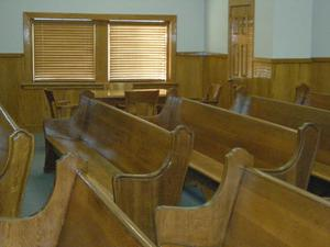 Primary view of object titled '[Benches in a Courtroom]'.