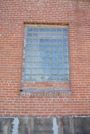 Primary view of object titled '[Window in Brick Building]'.